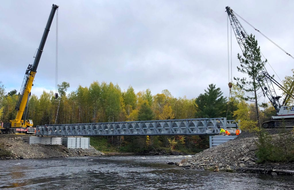 Wide view of Bailey Bridge and abutments package installation